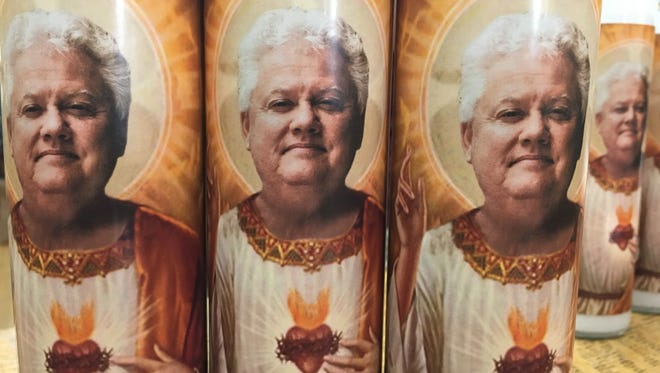 Local lawyer Scott Hoy featured on celebrity prayer candles sold at Zandbroz Variety in downtown Sioux Falls. News of the candles went viral and the six Hoy candles quickly sold out.