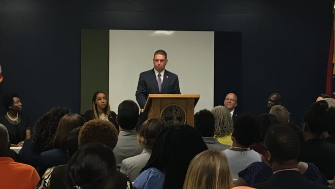 Tennessee Department of Correction Commissioner Tony Parker speaks during the opening of a day reporting center in Jackson on Wednesday, July 19.