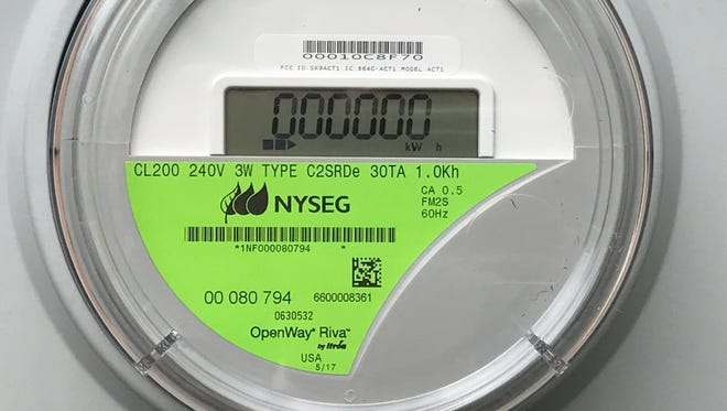 New York State Electric & Gas Corp.'s first smart installed at a West Jay Street house in Ithaca on Thursday, July 20, 2017.