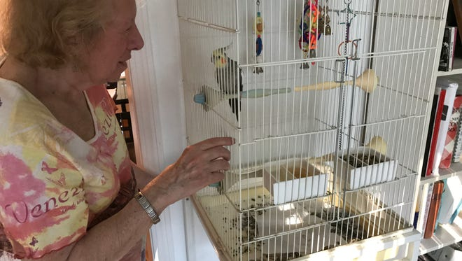 "Audrey Alben, 84, of Bergenfield, talks to her cockatiel, Billy. Police say her son and grandson have abused her by failing to provide certain ""necessities."""
