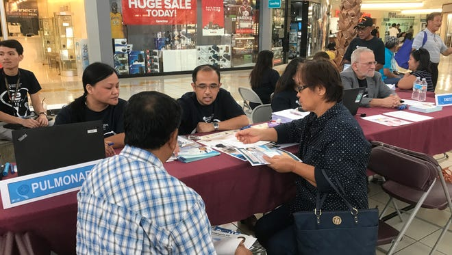 Visitors receive health information at the Guam Regional Medical City health fair at the Micronesia Mall on July 23, 2017.