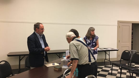 Historian Tom Huntington meets with members of the