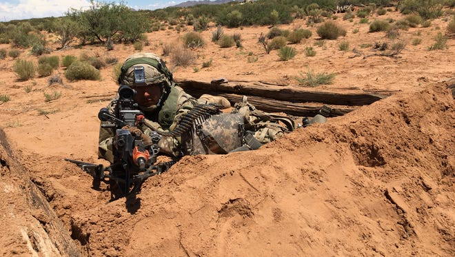 Spc. Jose Hernandez, with 1-26 Infantry from Fort Campbell, Ky., mans a defensive position during the Network Integration Evaluation at Fort Bliss.