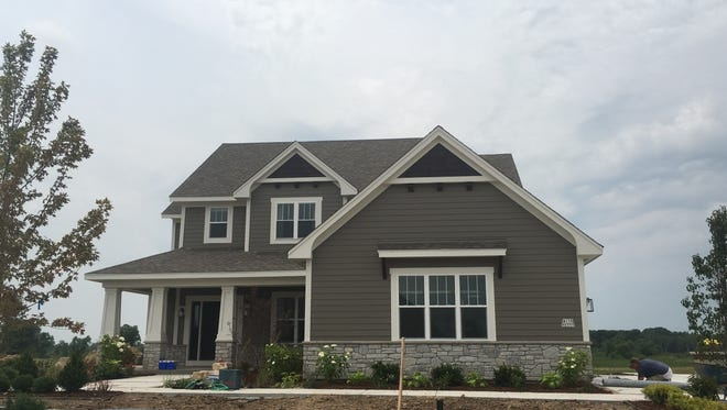 Construction crews are preparing 22 houses in metro Milwaukee for this year's MBA Parade of Homes, including this one by Aspen Homes in the Fox Meadow subdivision in Menomonee Falls. The parade starts Aug. 12.