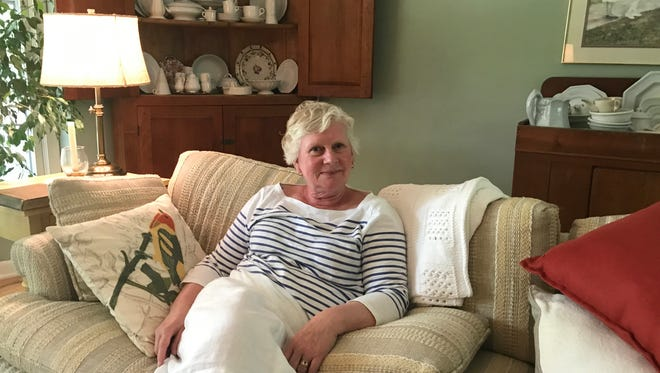 Kary Devereau, a retired Lansing teacher shown in her East Lansing home July 21, 2017, said it's unfair to ask her to be fingerprinted for the third time in order to substitute teach.