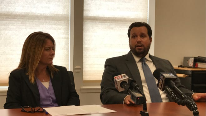 Wicomico County State's Attorney Ella Disharoon (left) and Assistant State's Attorney Jared Monterio discuss convictions in two Sharptown robbery cases on July 27, 2017.