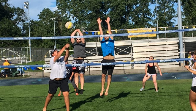 Friday night featured coed play at the Blue Water Volleygrass Festival at Port Huron Northern.