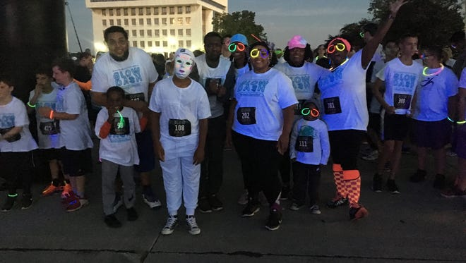 The Port Huron Recreational Department hosted the Glow Dash 2.5 Fun Run Friday night at Kiefer Park.