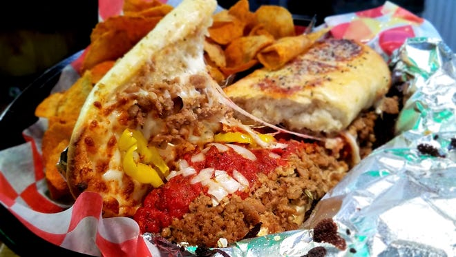 The Franklin Street Pizza Factory Stromboli is enhanced with bits of fresh onion and banana peppers to offset the richness of cheese, sausage and garlic butter. Maybe this is Evansville's best strom!