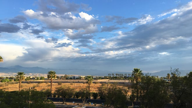 Gray clouds hover above the Coachella Valley Tuesday. Thunderstorms entered the desert late Monday and similar conditions may last through Wednesday, weather experts say.