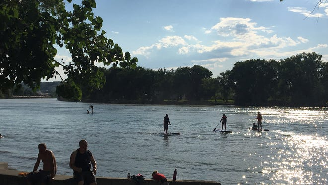 Attendees enjoy some paddleboarding during a 2016 Music on the Mo event in Oddfellows Park.