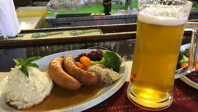 McKraut's Restaurant combo sausage plate, with knackwurst and smoked bratwurst, goes well with the Detmolder Pilsener.