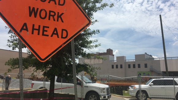 Crews work Wednesday at 301 Bibb St., the future site