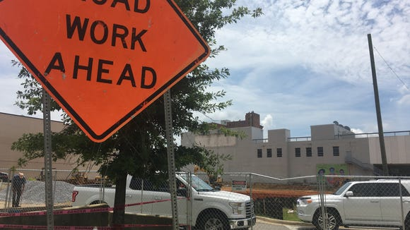 Crews work Wednesday at 301 Bibb St., the future site of a Staybridge Suites hotel.