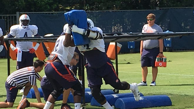 Auburn sophomore defensive end Marlon Davidson (3) attacking a dummy pad during preseason practice drills on Aug. 2, 2017.