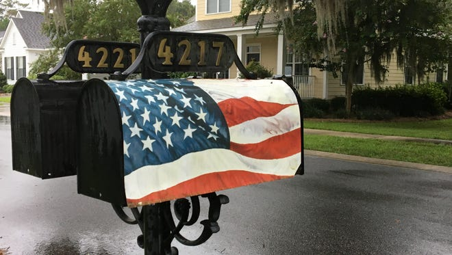 Retired U.S. Navy commander and Southwood resident John Ackert says his neighborhood association has asked him to remove the patriotic American flag cover on his mailbox.