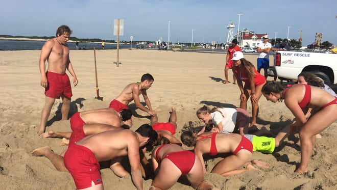The Ocean City Beach Patrol practices rescue techniques to be prepared for future situations involving sand collapses.