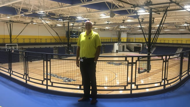 St. Clair County Community College Athletic Director Dale Vos stands on the indoor track of the SC4 Fieldhouse.