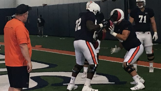Auburn offensive line coach Herb Hand watches Prince Michael Sammons in a 1-on-1 drill during preseason practice on Aug. 5, 2017