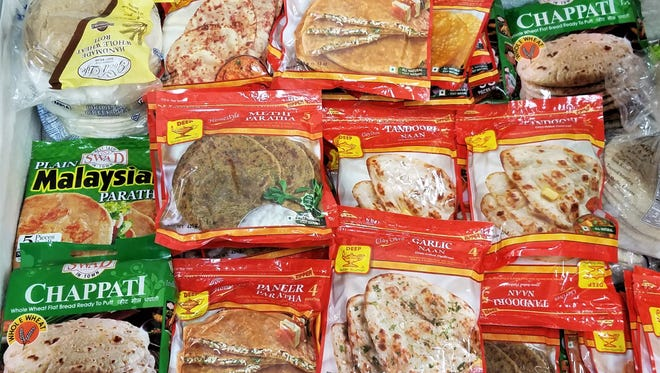 Even if you don't want to cook at all, International Bazaar carries a wealth of ready-to-eat meals and sides such as this selection of exotic flatbreads.