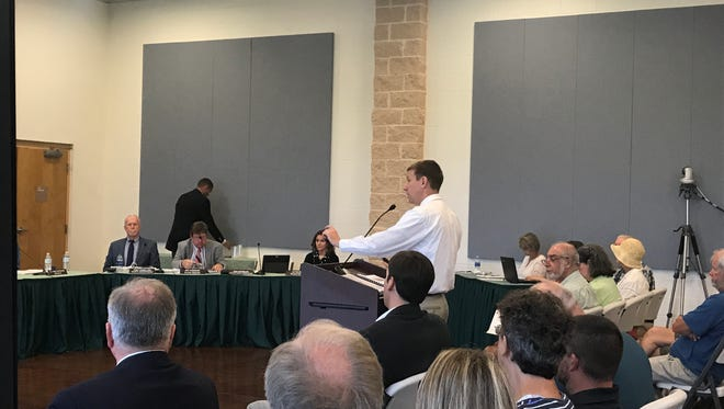 Ryan Weed, an engineer with Baskerville-Donovan in Pensacola, briefs the Santa Rosa County Commissioners on the firm's plan to alleviate stormwater drainage issues in the Navarre neighborhood of Holley by the Sea.
