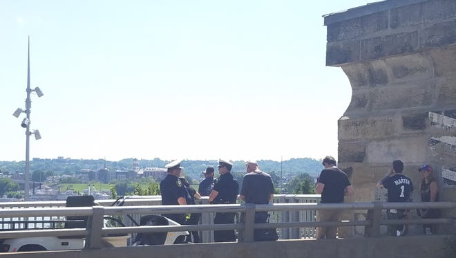 """Policemen - whether real or actors - gather on Roebling Bridge for filming of """"Reprisal."""""""