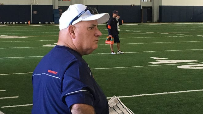 Auburn offensive analyst Al Borges look over practice during the first day of preseason workouts on July 31, 2017.