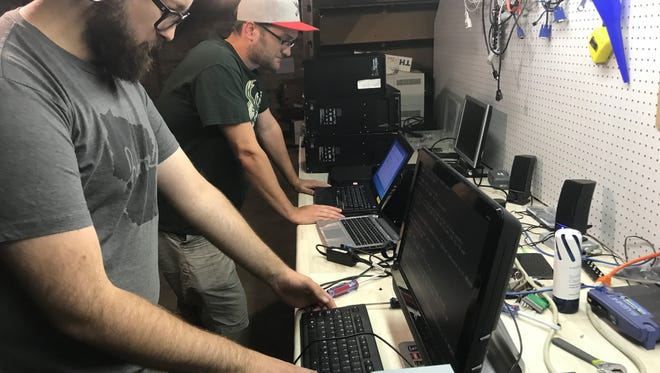 Matthew Hinz, left, and Dane Schaefer work on donated computers in the basement of Goodside Grocery on Thursday, Aug. 10. Funded by a SOUP dinner, Reboot Sheboygan takes donated computers and redistributes them to others who can't afford computers in the community.