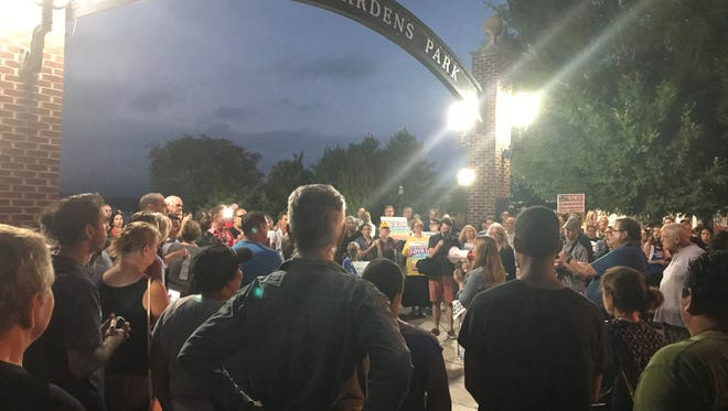 A couple hundred people gather at Riverside Gardens Park in Red Bank for a vigil after Saturday's events in Charlottesville, Virginia.