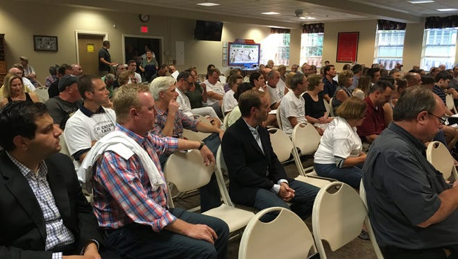 On Aug. 15, 2017, dozens attend a Village Board hearing about  a proposed moratorium on changes to the zoning code and issuing of special permits.
