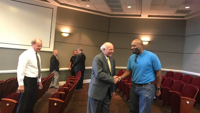 Collierville Mayor Stan Joyner and vandalism victim Pastor Jason Mitchell part company after a joint media conference at Collierville Town Hall on Tuesday