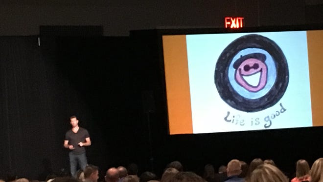 Bert Jacobs, co-founder of Life is Good, spoke to about 400 people at a conference of the Young Professional Network, explaining how the stick character, Jake, initially was just a face. Then he started eating ice cream, riding bike and enjoying nature.