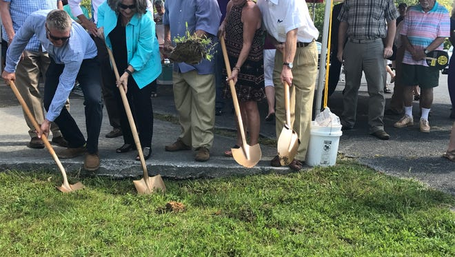 Knoxville Mayor Madeline Rogero, second from left, joins a ceremonial groundbreaking for the Baker Creek Bottoms redevelopment.