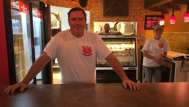 "Guy Beekman, front, owns The Fat Apple in North Fort Myers. ""We're old school,"" he says. ""The way we do pizza is becoming a lost art."""
