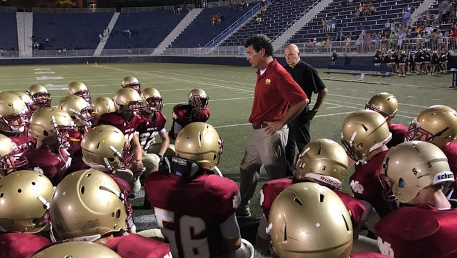 Coach Mike Goebel talks to his Mater Dei Wildcats after their season-opening loss.