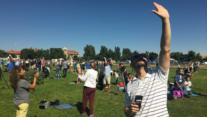 People fill the Weiser High School football field Aug. 21, 2017 in Weiser, Id. as the solar eclipse totality approaches.