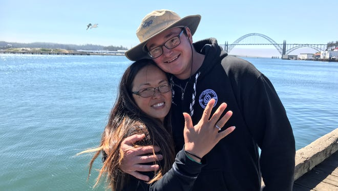Stephan Baker took the opportunity of the eclipse to propose to Julia DuBois in Newport, Ore.