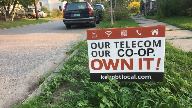 A yard sign in Burlington seen Monday, Aug. 21, 2017, supports efforts for a local coop to buy Burlington Telecom.