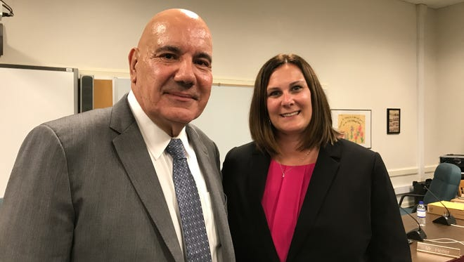 Bloomfield Schools Superintendent Sal Goncalves, left, celebrates his new contract, and Lauren Barton, right, is named principal of Brookdale Elementary School' on Aug. 22, 2017.