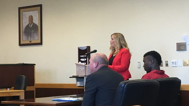 Attorney Danielle O'Halloran argues in court Wednesday. Tommy Williams, one of 22 men arrested and accused of being part of the a Fort Myers gang known as the Lake Boyz, sits behind her. Williams is not one of her clients.