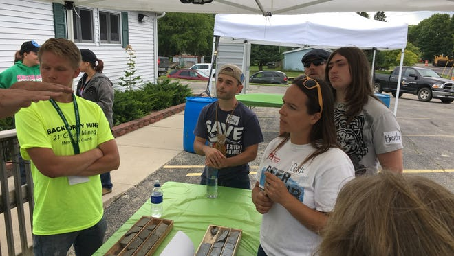 Opponents of the Back Forty Mine attended a recent open house held by Aquila Resources at its headquarters in Stephenson, Mich.
