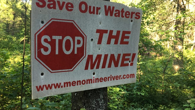 A sign expresses a property owner's opposition to Aquila Resources' plan to open a pit mine near the Menominee River in Michicgan.