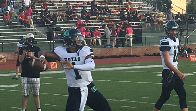 Five-star 2018 QB prospect Justin Fields from Harrison High School (Kennesaw, Ga.) warming up before a road game at Rome (Ga.) High School on Aug. 25, 2017.