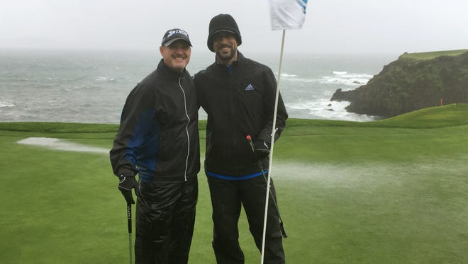 Jerry Kelly (left) and Aaron Rodgers pose on the eighth green at Pebble Beach on Feb. 7, 2017.