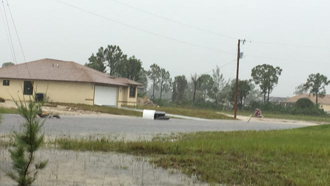 Deadly parasites and bacteria often lurk in flood waters. A portable toilet flipped in Cape Coral.