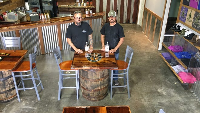 Leatherwood Distillery is set to open in September in Pleasant View. Founder Andrew Lang is pictured with one of his partners, Masoud Rezai.