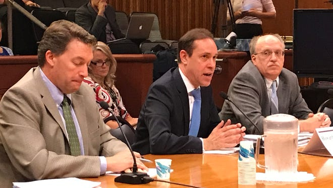 New York State Health Commissioner Howard Zucker, center, testifies at a state Senate hearing on Lyme disease and tick-borne illness on Tuesday, Aug. 29, 2017, near the state Capitol in Albany.