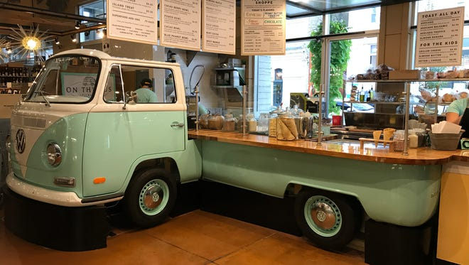 On the Bus, a plant-based food stand built from a 1971 Volkswagen bus, opened in the Milwaukee Public Market on Monday.