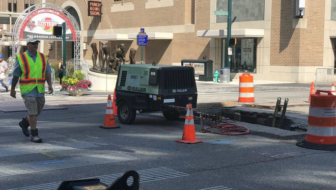 Crews with Citizens Thermal continue to work on a steam leak repair project at the intersection of Meridian and Georgia streets in Downtown Indianapolis.