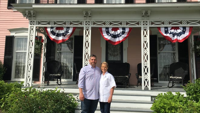 Bill and Donna Hutches, a Haddon Township couple, stand in front of the Pleasant Valley Inn in the Finger Lakes region of New York. They bought the business after enjoying dining there for years.